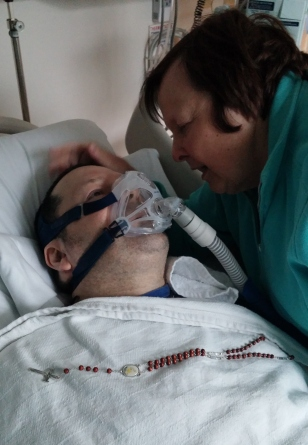 My Mother tending to Davy a day after the miracle. The last Photo of Davy alive 8 November 2013.